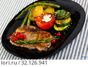 Купить «Veal with baked vegetables is tasty dish», фото № 32126941, снято 27 июня 2018 г. (c) Яков Филимонов / Фотобанк Лори