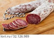 Купить «Sliced dry cured sausage Llonganissa», фото № 32126989, снято 20 сентября 2019 г. (c) Яков Филимонов / Фотобанк Лори