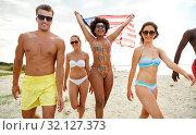 Купить «happy friends with american flag on summer beach», фото № 32127373, снято 29 июля 2018 г. (c) Syda Productions / Фотобанк Лори