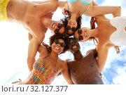 Купить «happy friends hugging over sky on summer beach», фото № 32127377, снято 29 июля 2018 г. (c) Syda Productions / Фотобанк Лори