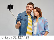 Купить «happy couple taking selfie by smartphone», фото № 32127429, снято 17 марта 2019 г. (c) Syda Productions / Фотобанк Лори