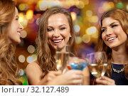 Купить «happy women clinking glasses at night club», фото № 32127489, снято 21 ноября 2015 г. (c) Syda Productions / Фотобанк Лори