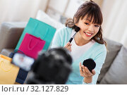 Купить «female beauty blogger making video about make up», фото № 32127829, снято 13 апреля 2019 г. (c) Syda Productions / Фотобанк Лори