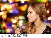 woman with glass of champagne at night club. Стоковое фото, фотограф Syda Productions / Фотобанк Лори
