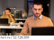 Купить «man with computer working late at night office», фото № 32128009, снято 26 ноября 2017 г. (c) Syda Productions / Фотобанк Лори
