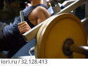 Купить «close up of man exercising on gym machine», фото № 32128413, снято 2 июля 2017 г. (c) Syda Productions / Фотобанк Лори