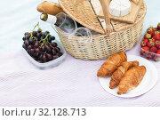 Купить «picnic basket, food and wine glasses on blanket», фото № 32128713, снято 9 августа 2017 г. (c) Syda Productions / Фотобанк Лори