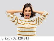 Купить «happy woman in pullover holding to her head», фото № 32128813, снято 6 марта 2019 г. (c) Syda Productions / Фотобанк Лори