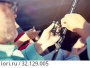 Купить «senior man with fishing rod or spinning on river», фото № 32129005, снято 9 июля 2016 г. (c) Syda Productions / Фотобанк Лори