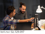 Купить «creative team with computer working late at office», фото № 32129097, снято 24 января 2018 г. (c) Syda Productions / Фотобанк Лори