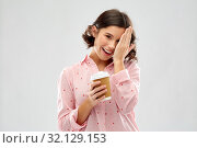 Купить «happy young woman in pajama with cup of coffee», фото № 32129153, снято 6 марта 2019 г. (c) Syda Productions / Фотобанк Лори