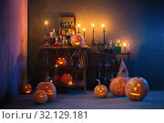Halloween decoration with pumpkins and magic potions indoor. Стоковое фото, фотограф Майя Крученкова / Фотобанк Лори