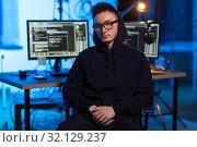 Купить «asian hacker in dark room with computers at night», фото № 32129237, снято 27 марта 2019 г. (c) Syda Productions / Фотобанк Лори