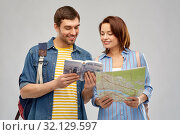 Купить «happy couple of tourists with city guide and map», фото № 32129597, снято 17 марта 2019 г. (c) Syda Productions / Фотобанк Лори