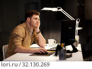Купить «tired or bored man working late at night office», фото № 32130269, снято 26 ноября 2017 г. (c) Syda Productions / Фотобанк Лори