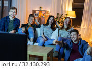 Купить «happy friends watching tv at home in evening», фото № 32130293, снято 22 декабря 2018 г. (c) Syda Productions / Фотобанк Лори