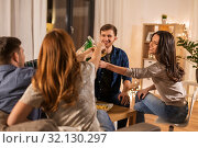 Купить «friends clinking drinks at home in evening», фото № 32130297, снято 22 декабря 2018 г. (c) Syda Productions / Фотобанк Лори