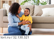 Купить «happy african american mother with baby at home», фото № 32130321, снято 22 марта 2019 г. (c) Syda Productions / Фотобанк Лори