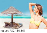 Купить «young woman posing in bikini on beach», фото № 32130361, снято 11 июля 2013 г. (c) Syda Productions / Фотобанк Лори