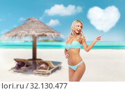 Купить «happy smiling young woman in bikini on beach», фото № 32130477, снято 20 апреля 2017 г. (c) Syda Productions / Фотобанк Лори