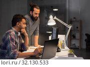 Купить «creative team with computer working late at office», фото № 32130533, снято 24 января 2018 г. (c) Syda Productions / Фотобанк Лори