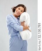 Купить «happy young woman in pajama hugging pillow», фото № 32130781, снято 6 марта 2019 г. (c) Syda Productions / Фотобанк Лори