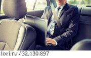 Купить «senior businessman with laptop driving in car», фото № 32130897, снято 16 июля 2016 г. (c) Syda Productions / Фотобанк Лори