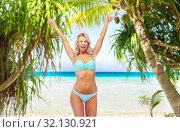 Купить «happy young woman in bikini doing fist pump», фото № 32130921, снято 20 апреля 2017 г. (c) Syda Productions / Фотобанк Лори