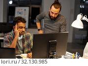 Купить «creative team with computer working late at office», фото № 32130985, снято 24 января 2018 г. (c) Syda Productions / Фотобанк Лори