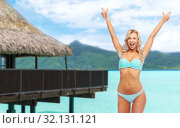 Купить «happy young woman in bikini doing fist pump», фото № 32131121, снято 20 апреля 2017 г. (c) Syda Productions / Фотобанк Лори