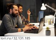 Купить «creative team with computer working late at office», фото № 32131185, снято 24 января 2018 г. (c) Syda Productions / Фотобанк Лори