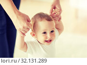 Купить «happy baby learning to walk with mother help», фото № 32131289, снято 12 июля 2016 г. (c) Syda Productions / Фотобанк Лори