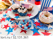 Купить «food and drinks on american independence day party», фото № 32131361, снято 28 мая 2015 г. (c) Syda Productions / Фотобанк Лори