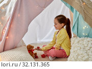 Купить «girl playing tea party with teddy in kids tent», фото № 32131365, снято 18 февраля 2018 г. (c) Syda Productions / Фотобанк Лори