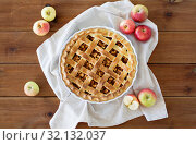 Купить «apple pie in baking mold on wooden table», фото № 32132037, снято 23 августа 2018 г. (c) Syda Productions / Фотобанк Лори