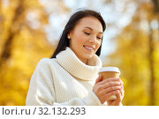 Купить «woman drinking takeaway coffee in autumn park», фото № 32132293, снято 13 октября 2018 г. (c) Syda Productions / Фотобанк Лори