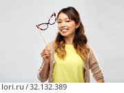 Купить «happy asian woman with big party glasses», фото № 32132389, снято 11 мая 2019 г. (c) Syda Productions / Фотобанк Лори