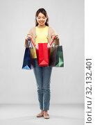 Купить «happy asian woman with shopping bags», фото № 32132401, снято 11 мая 2019 г. (c) Syda Productions / Фотобанк Лори