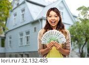 Купить «asian woman with hundred euro money banknotes», фото № 32132485, снято 11 мая 2019 г. (c) Syda Productions / Фотобанк Лори