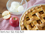 Купить «apple pie with ice cream on wooden table», фото № 32132521, снято 23 августа 2018 г. (c) Syda Productions / Фотобанк Лори