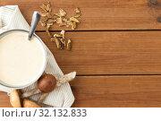 Купить «mushroom cream soup in bowl on cutting board», фото № 32132833, снято 13 сентября 2018 г. (c) Syda Productions / Фотобанк Лори