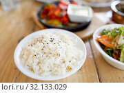 Купить «close up of boiled rice in bowl on table», фото № 32133029, снято 2 мая 2017 г. (c) Syda Productions / Фотобанк Лори