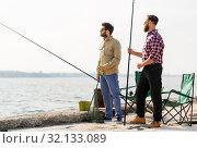 Купить «male friends with fishing rods and beer on pier», фото № 32133089, снято 8 сентября 2018 г. (c) Syda Productions / Фотобанк Лори