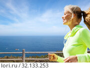 woman with earphones running at seaside. Стоковое фото, фотограф Syda Productions / Фотобанк Лори