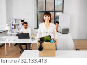 Купить «happy businesswoman with personal stuff at office», фото № 32133413, снято 23 марта 2019 г. (c) Syda Productions / Фотобанк Лори