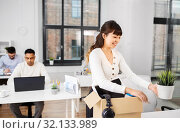 Купить «happy businesswoman with personal stuff at office», фото № 32133989, снято 23 марта 2019 г. (c) Syda Productions / Фотобанк Лори