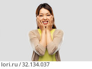 Купить «happy amazed asian woman over grey background», фото № 32134037, снято 11 мая 2019 г. (c) Syda Productions / Фотобанк Лори