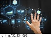 Купить «hand using black interactive panel with charts», фото № 32134093, снято 31 мая 2018 г. (c) Syda Productions / Фотобанк Лори