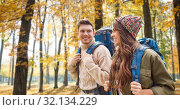 Купить «smiling couple with backpacks hiking in autumn», фото № 32134229, снято 31 августа 2014 г. (c) Syda Productions / Фотобанк Лори