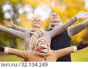 Купить «happy family having fun in autumn park», фото № 32134249, снято 12 октября 2014 г. (c) Syda Productions / Фотобанк Лори